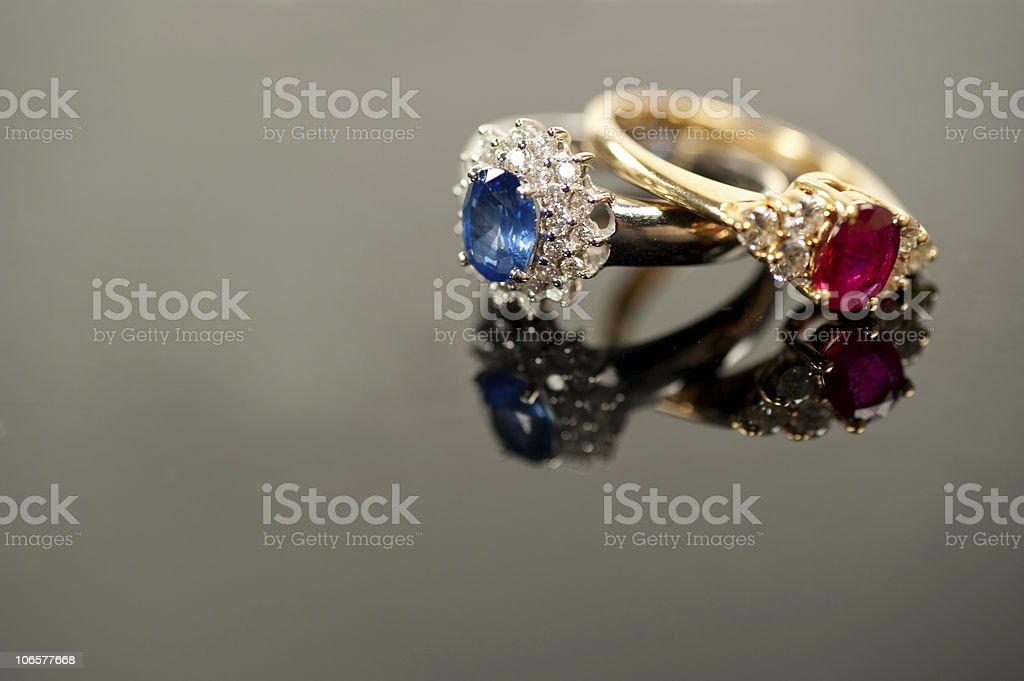 red and blue sapphire rings in diamond settings royalty-free stock photo