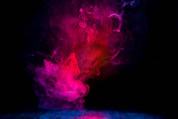 red and blue smoke patterns red and blue smoke patterns at dark background evaporation stock pictures, royalty-free photos & images