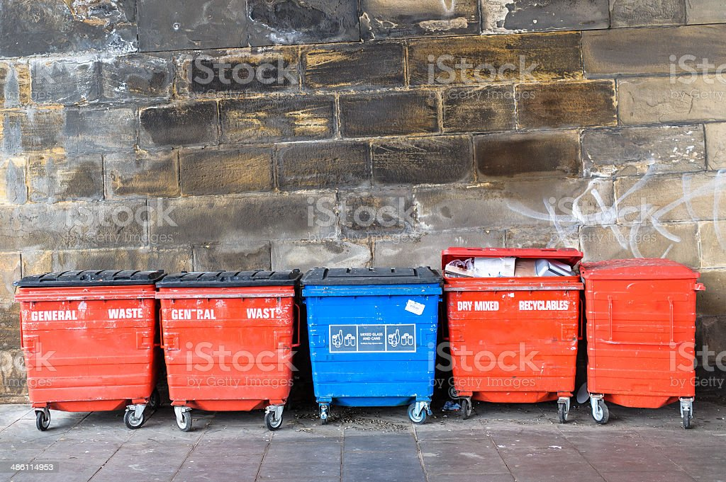 Red and blue street litter bins, rubbish bins. royalty-free stock photo