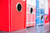 Red and blue stacked vintage business paper folders