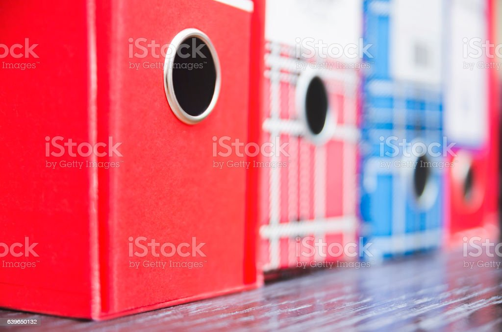 Red and blue vintage business paper folders stock photo