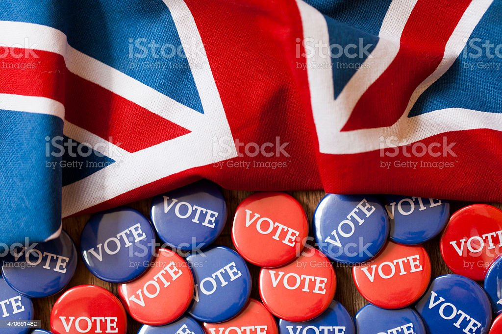 Red and blue voting badges with the union jack flag stock photo