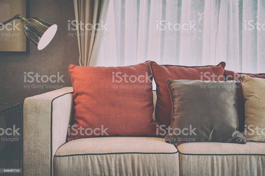 Swell Red And Brown Pillows On Sofa In Living Room Stock Photo Alphanode Cool Chair Designs And Ideas Alphanodeonline