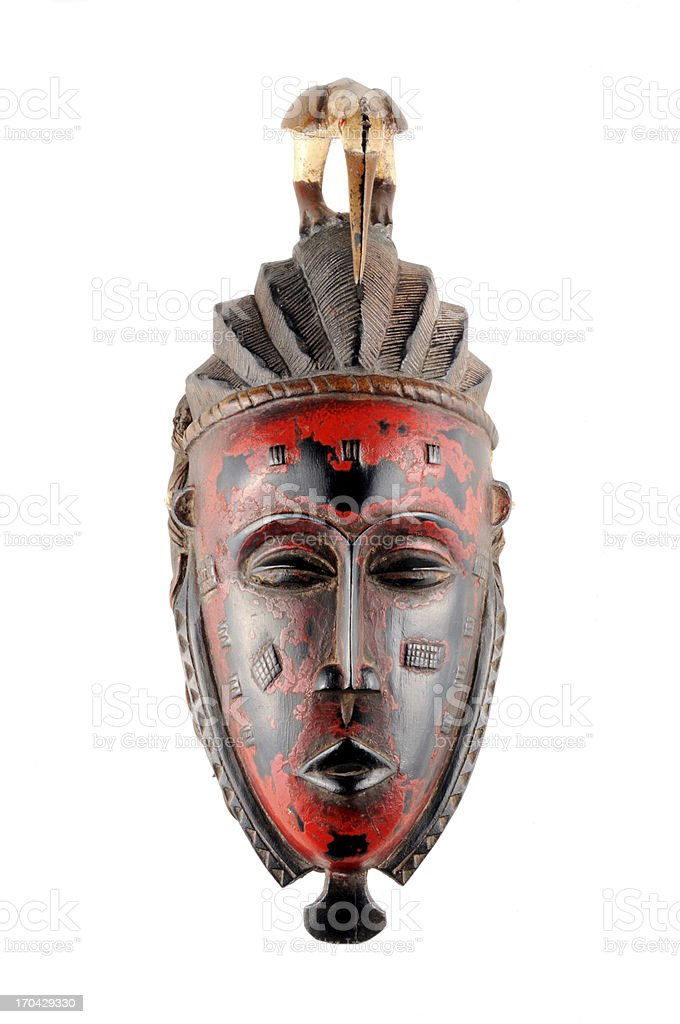 Red and brown traditional tribal mask From Mali stock photo