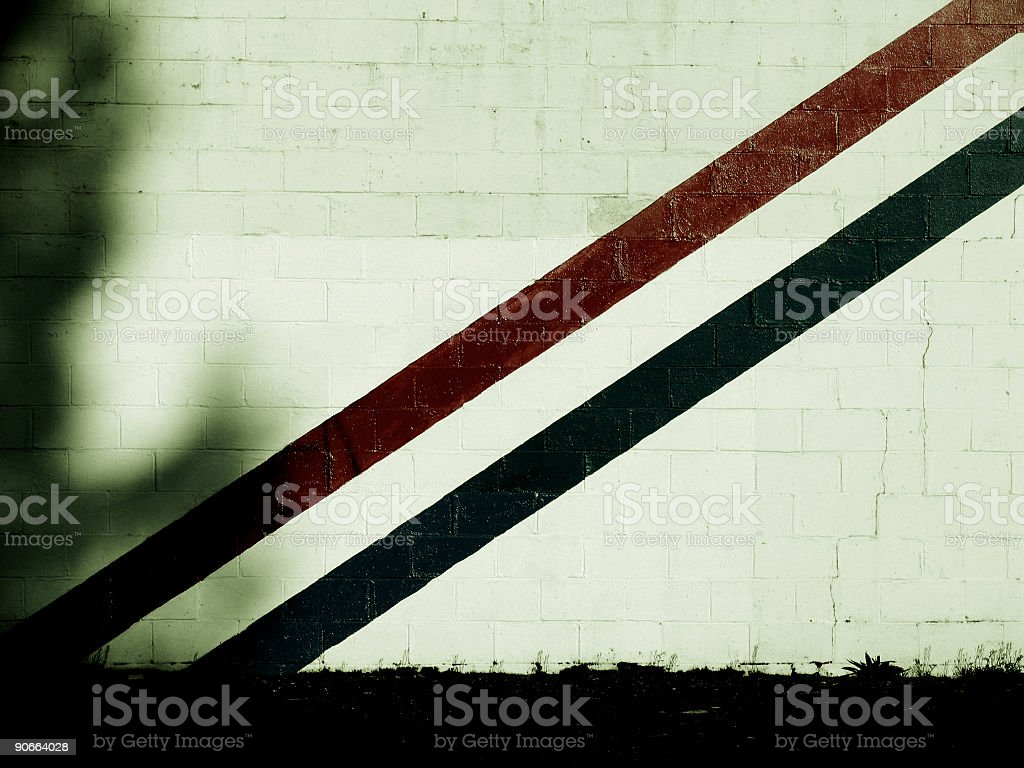 Red and Dark Blue Striped Brick Wal royalty-free stock photo