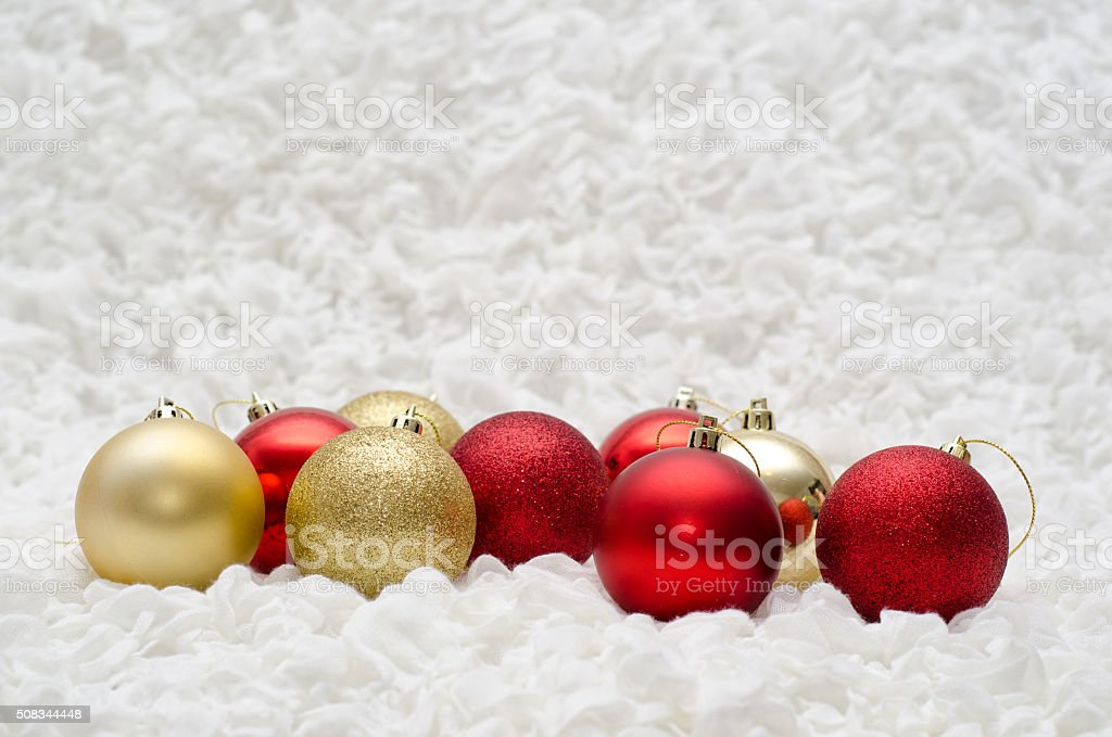 red and gold christmas balls ornaments on white background picture id508344448