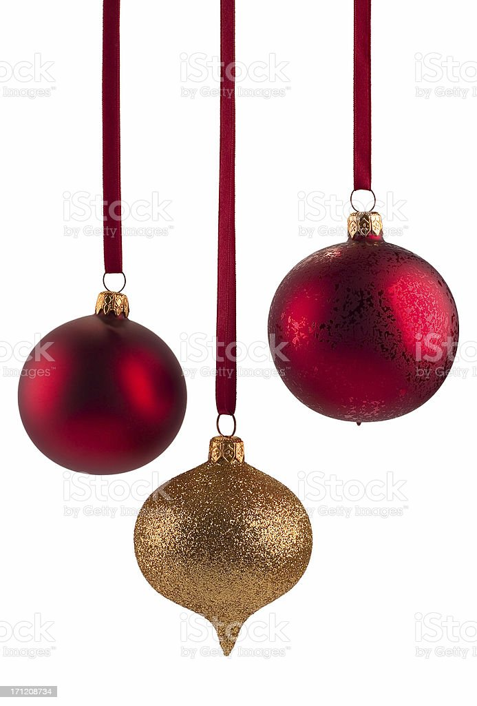 Red and gold Christmas baubles on white background royalty-free stock photo