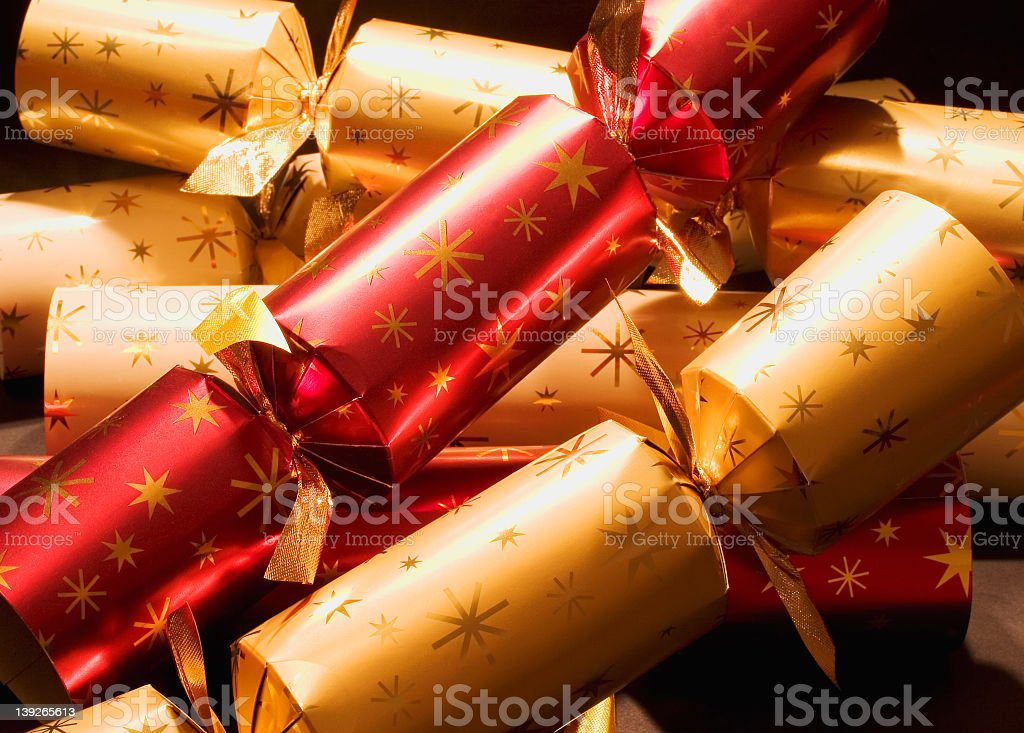 Red and gold Christmas crackers stock photo