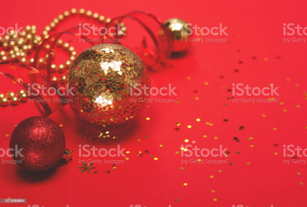 red and gold christmas ornaments on red background picture id1073283654