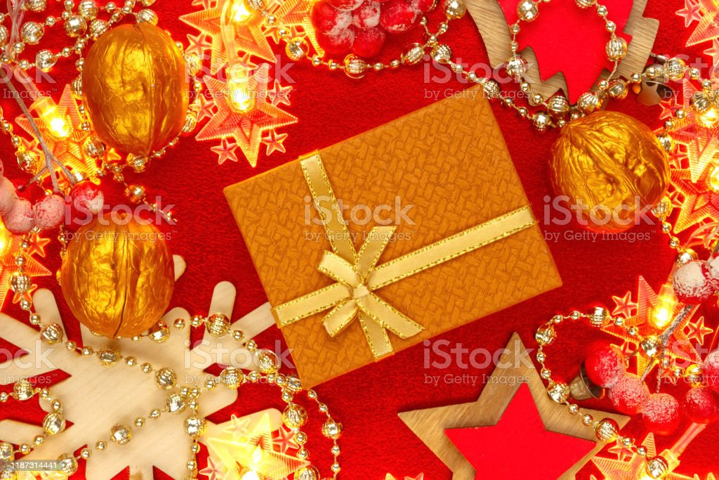red and golden background with christmas decorations and garlands picture id1187314441