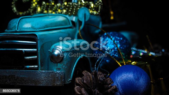 istock red and golden christmas decorations with evergreen tree on blue snow bokeh background with mery christmas words 893008978