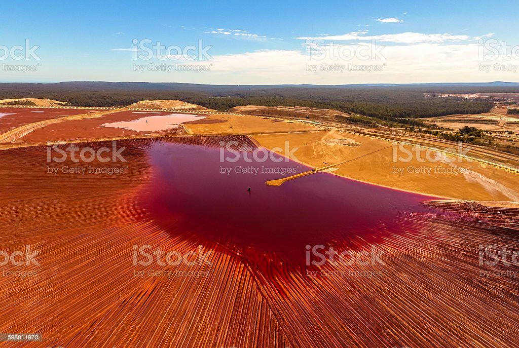 Red and Golden Tailing Ponds under Blue Sky Summer Day stock photo
