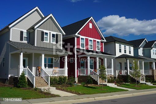 istock Red and Gray Row Houses in Suburbia 1284635683
