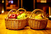 Red and green apples are in a small basket