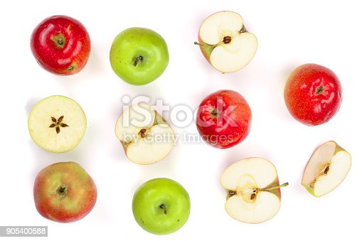 istock red and green apples with slices isolated on white background top view. Flat lay pattern 905400588
