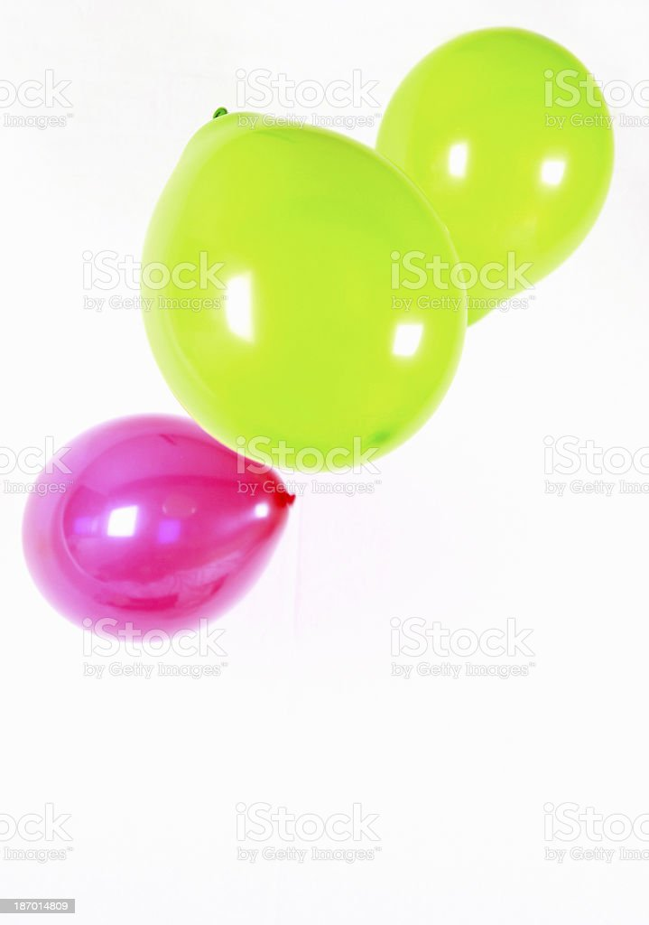 Red and green balloons floating in air royalty-free stock photo
