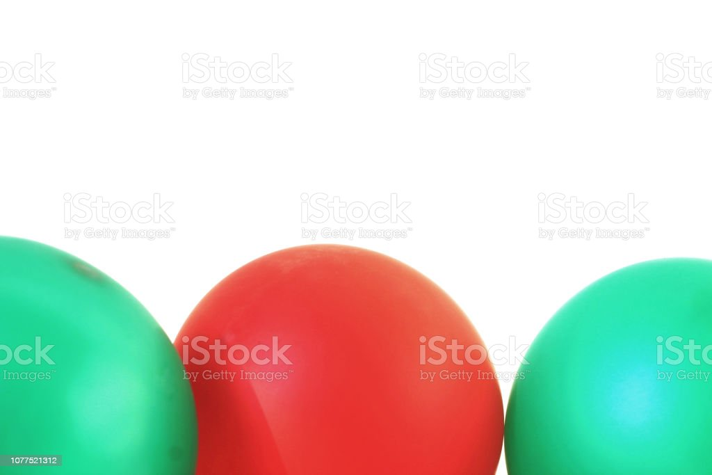 3 red and green balloons with white background stock photo