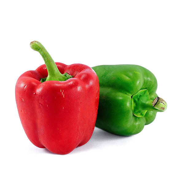 Red and green bell peppers isolated on white background stock photo