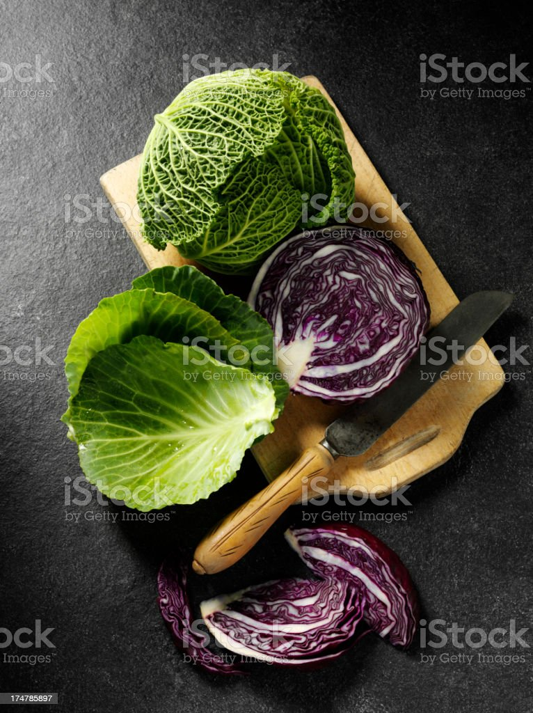 Red and Green Cabbage on a Chopping Board stock photo
