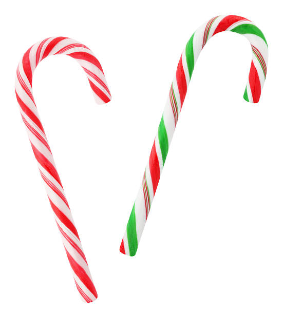 Red and green candy canes Christmas red and green candy canes isolated on white candy cane stock pictures, royalty-free photos & images