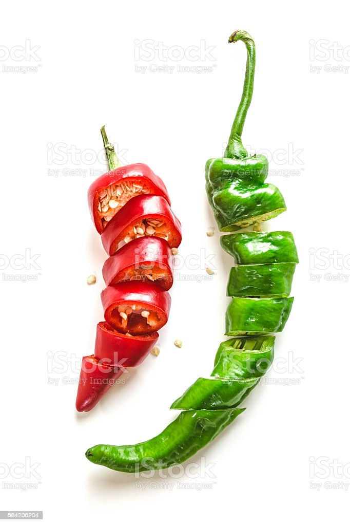 Red and Green Chili Peppers Sliced on White Background stock photo