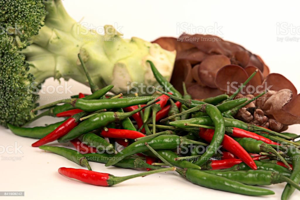 Red and green chilli,broccoli and jew's Ear mushrooms on white background stock photo