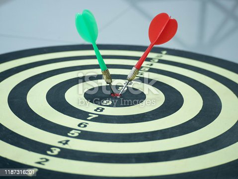 Red and Green dart target arrow hitting on bullseye which is the ultimate goal that everyone wants, Target marketing and business success concept.