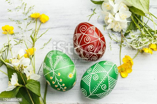 Three pysanky handmade Easter eggs. Ukrainian pysanky decorated with wax-resist dyeing technique. Holiday postcard