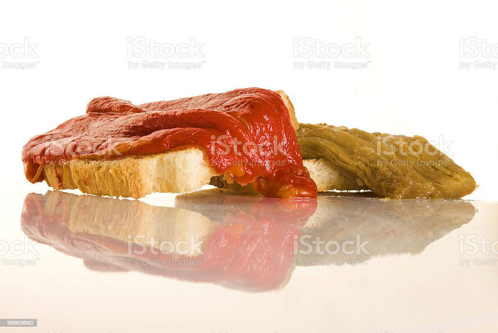 Red and green grilled pepper on bread royalty-free stock photo