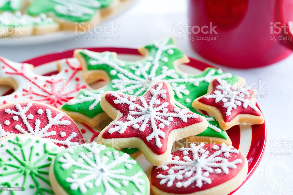 Red and green iced Christmas biscuits stock photo
