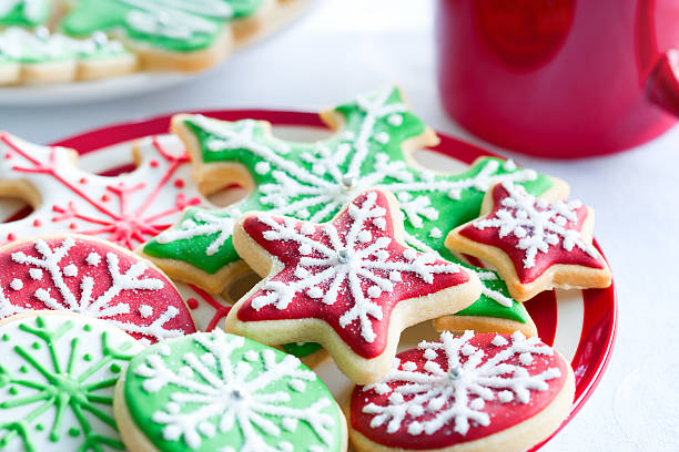 Red and green iced Christmas biscuits Colorful Christmas cookies on a plate sugar cookie stock pictures, royalty-free photos & images