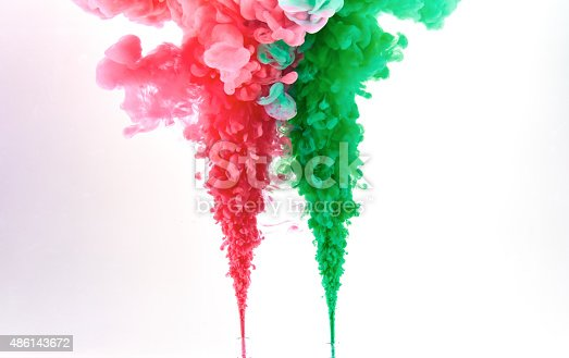 istock Red and green ink making clouds in water 486143672