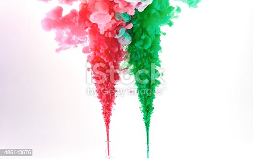 istock Red and green ink making clouds in water 486143676