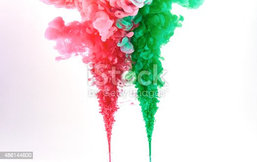 istock Red and green ink making clouds in water 486144600