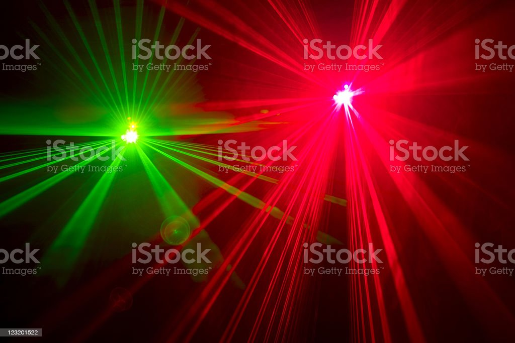 Red and green laser lights, long exposure stock photo