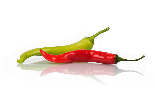 red and green pepper - green chilli pepper stock photos and pictures