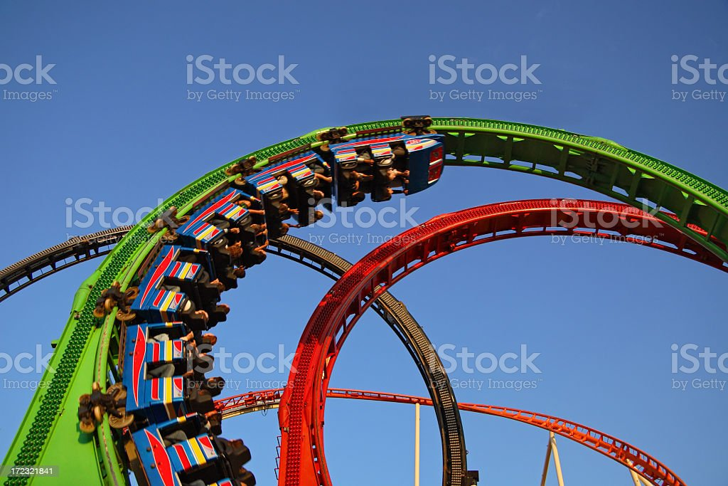 Red and green rollercoaster ride stock photo