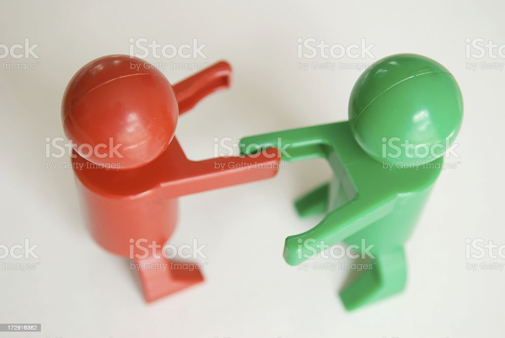 Red and Green Shake Hands stock photo