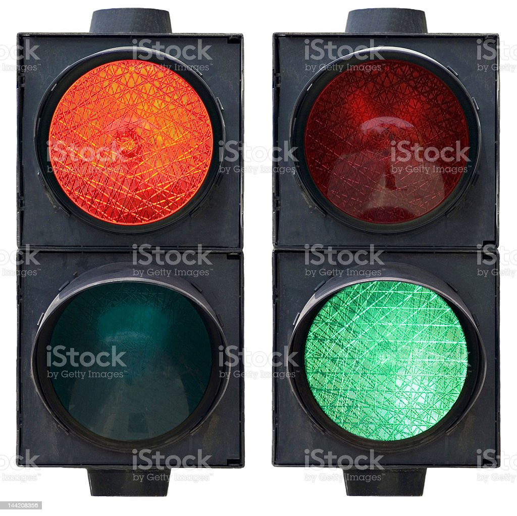 A red and green traffic light against a white background stock photo