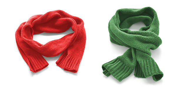Red and green warm scarves on a white background. Red and green warm scarves on a white background. headscarf stock pictures, royalty-free photos & images