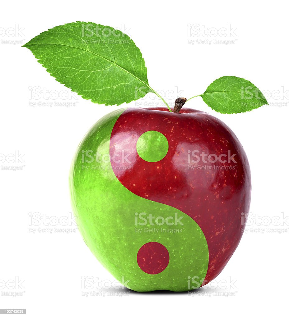 Red and green yin and yang apple design stock photo