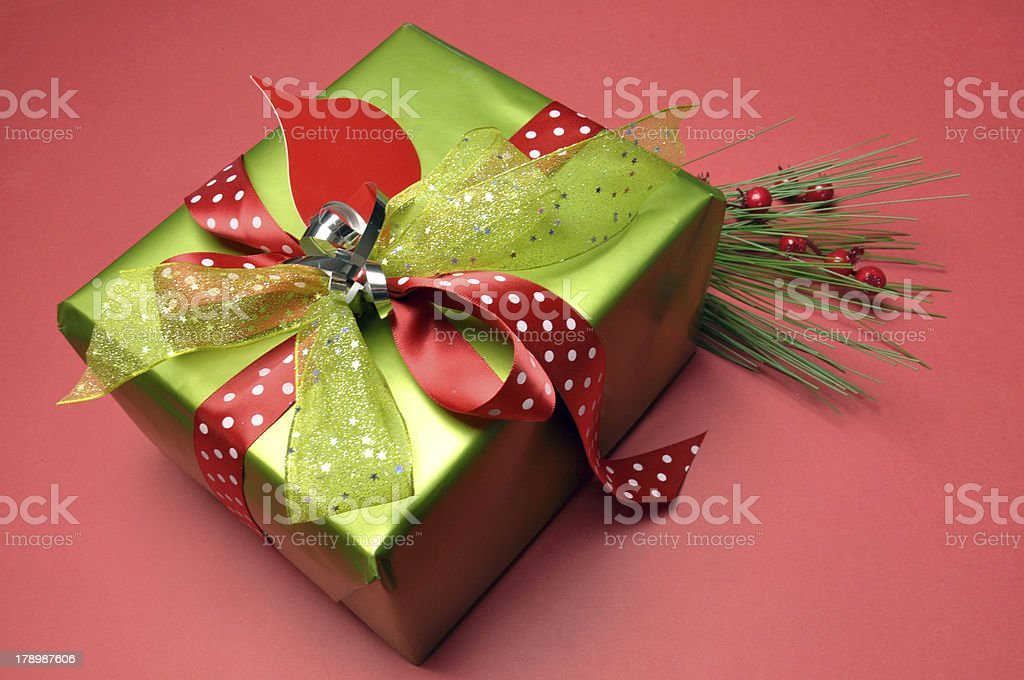 Red and lime green polka dot modern festive present gift. royalty-free stock photo