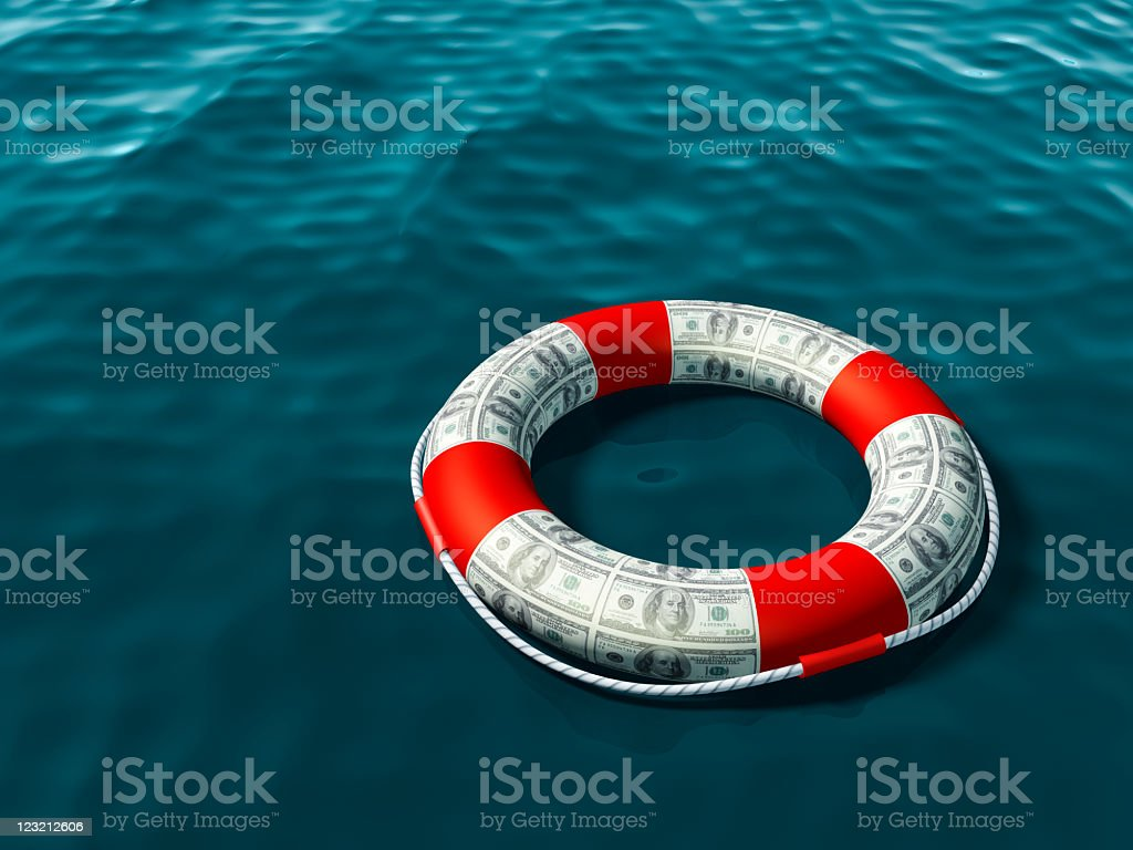 Red and money patterned life preserver in the water stock photo