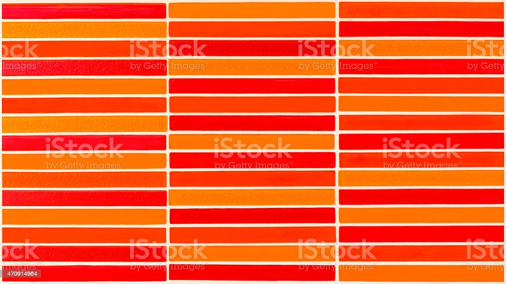 Red and orange ceramic wall tiled stock photo