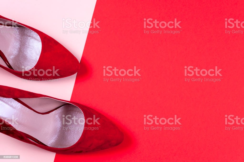 Red and pastel female high-heeled shoes stock photo