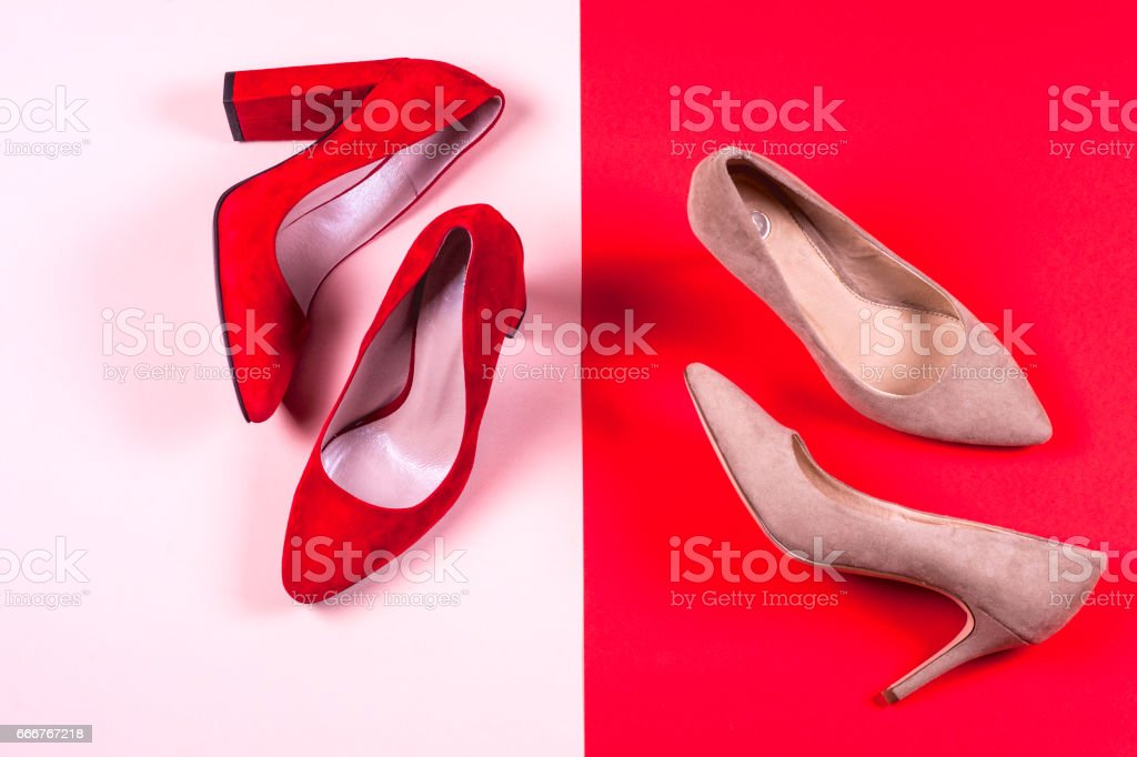 Red and pastel female high-heeled shoes foto stock royalty-free