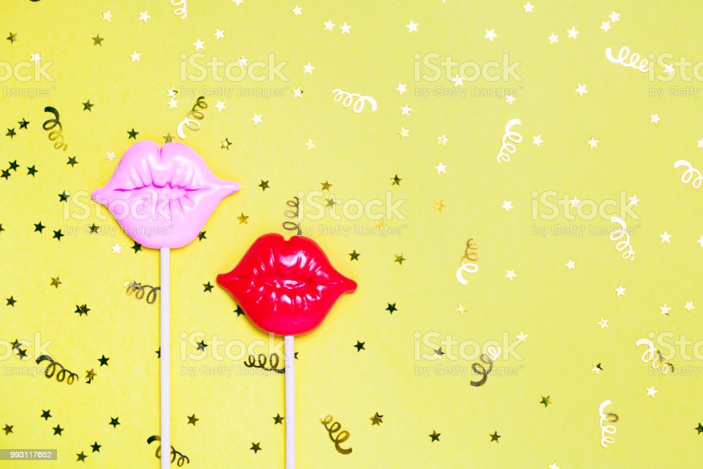 Red and pink lips for fun on yellow festive background. stock photo
