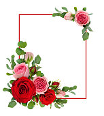 istock Red and pink rose flowers with eucalyptus leaves in a corner arrangements with  frame 928473112
