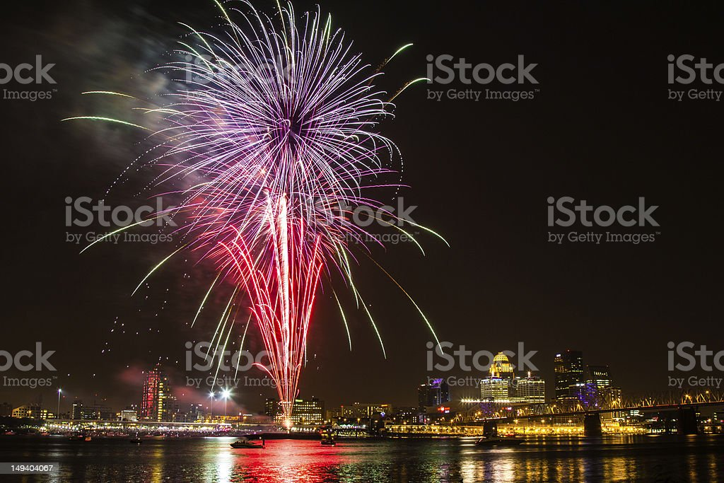 Red and purple Fourth of July fireworks at Louisville, KY stock photo