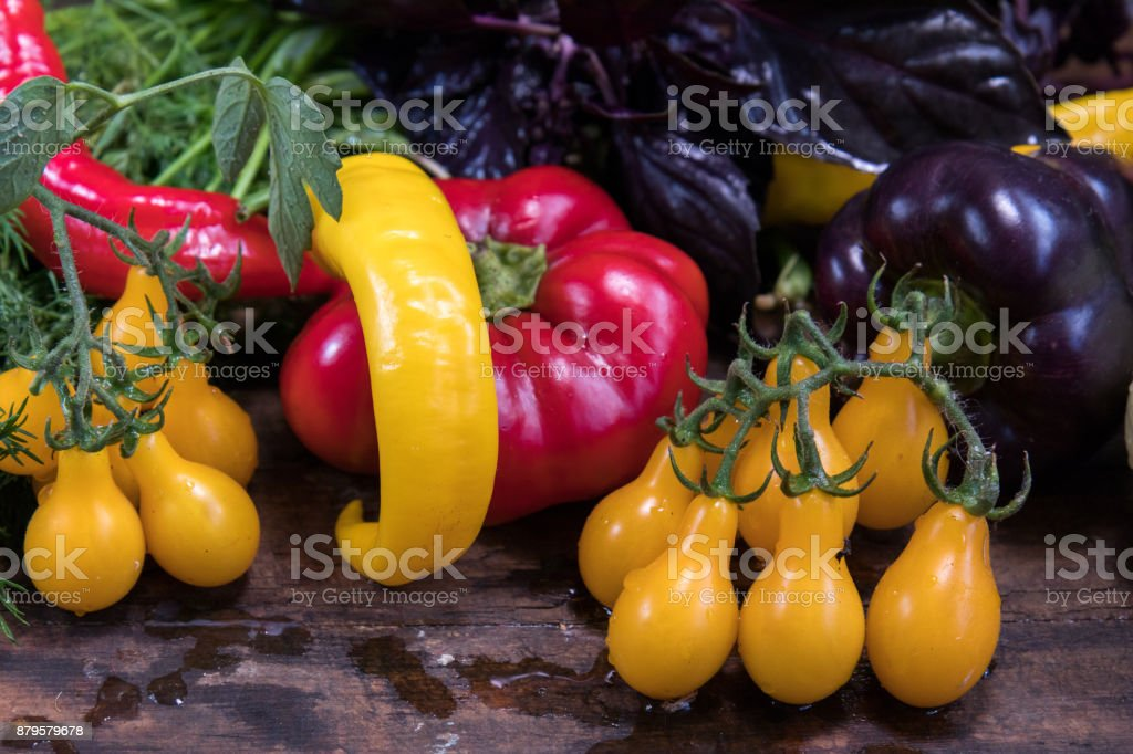 Red and purple sweet pepper and yellow tomatoes royalty-free stock photo